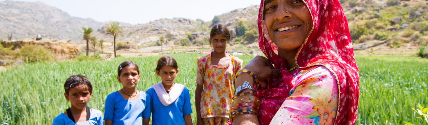 Indian woman and her four children, living from hand to mouth, secluded from modern society on Mount Abu in Rajasthan, India.